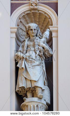 ZAGREB, CROATIA - FEBRUARY 15: Statue on facade of the old city building in Zagreb, Croatia on February 15, 2015
