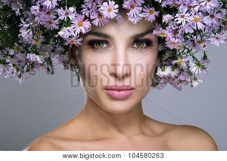 beauty woman with flowers on gray background