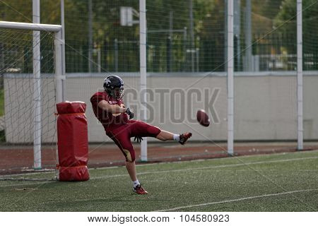PUSHKIN, LENINGRAD OBLAST, RUSSIA - OCTOBER 10, 2015: Player of team Russia kick the ball during qualifying match of American Football European Championship 2016 against Norway. Russia won the match