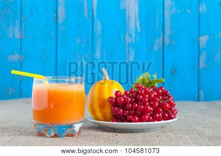 Branch of rowan berries, yellow striped pumpkin and pumpkins juice or smoothie. Autumn postcard back