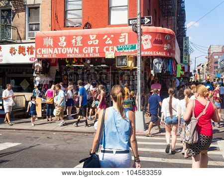 NEW YORK,USA - AUGUST 15,2015 : Tourists and souvenirs shop at Chinatown in New York City