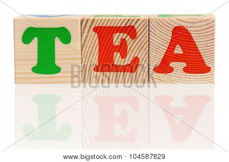TEA word formed by wood alphabet blocks, isolated on white background