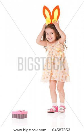 Funny little girl with rabbit ears, isolated on white background
