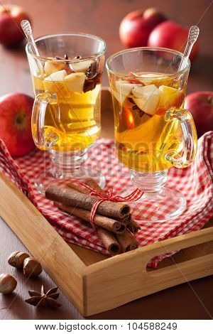 glass of mulled cider with orange and spices, winter hot drink