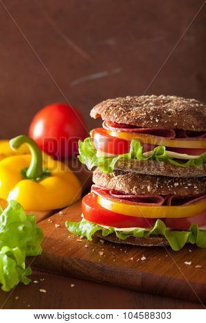 healthy salami sandwich with tomato pepper and lettuce