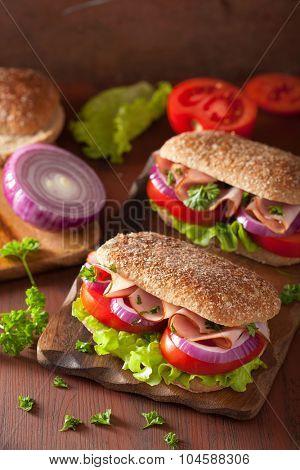 ham sandwich with tomato onion lettuce