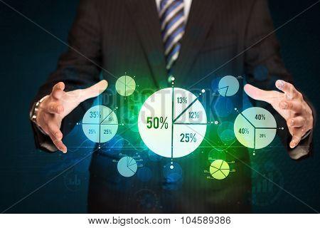 Businessman holding business diagrams, concept of success