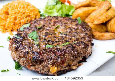 steak veal - beef meat with tomato and potatoes