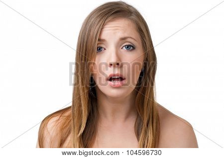 Young woman making faces, isolated on white background