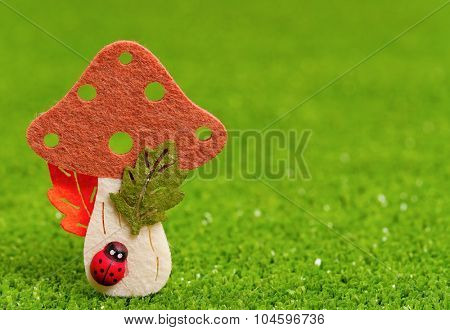 Artificial small mushrooms on artificial green grass