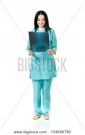 Female doctor examining an x-ray picture on white background