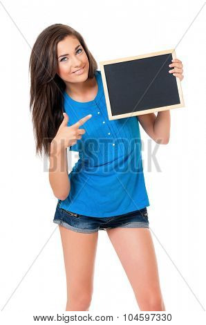 Beautiful teen girl with small blackboard posing on white background