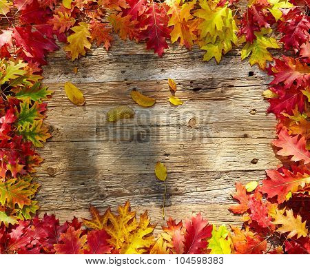Autumn leaves on a wooden table. Background style