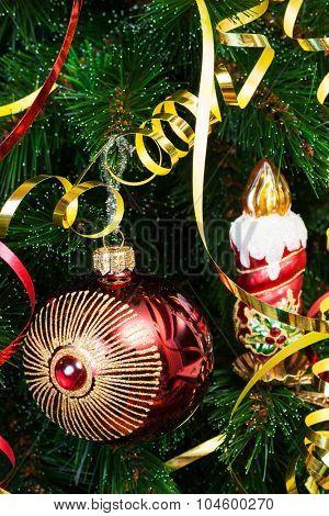 ball and candle on a Christmas tree