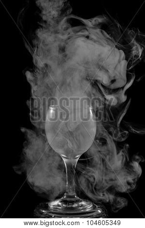 Smoke Shisha In Cocktail Glass On A Black Background.