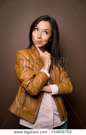 Thinking Asian Business Woman Smiling Looking To The Side. Beautiful Young Mixed Race Asian Caucasia