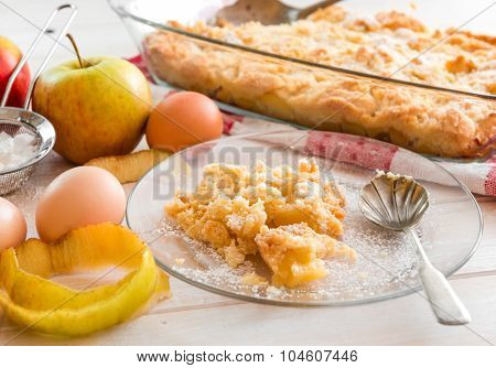 home made apple pie on a wooden background