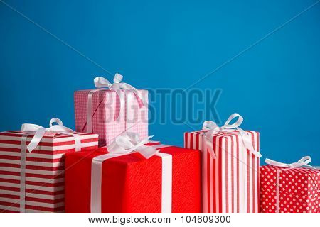 Gift boxes on the blue background
