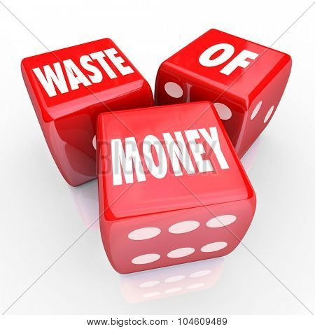 Waste of Money words on 3 red dice to illustrate wasteful spending or unwise purchase