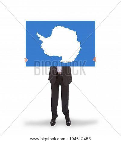 Smiling Businessman Holding A Big Card, Flag Of Antarctica