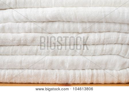 Stack Of Eco Friendly Washeable Textile Diapers - White Textile Background