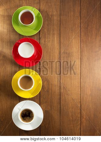 cup of tea, milk, coffee on wooden background