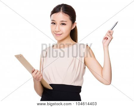 Businesswoman hold with file pad and pen point up