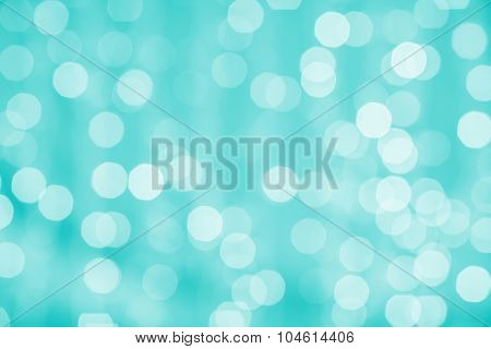 holidays, party and celebration concept - blurred green blue background with bokeh lights