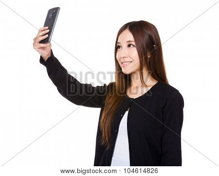 Asian Young woman take selfie by mobile phone