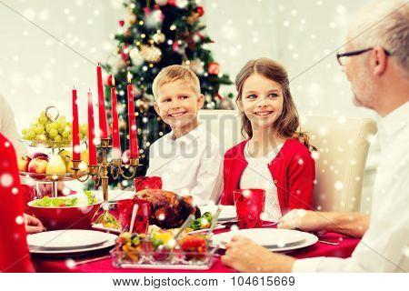 family, holidays, generation, christmas and people concept - smiling family having dinner at home
