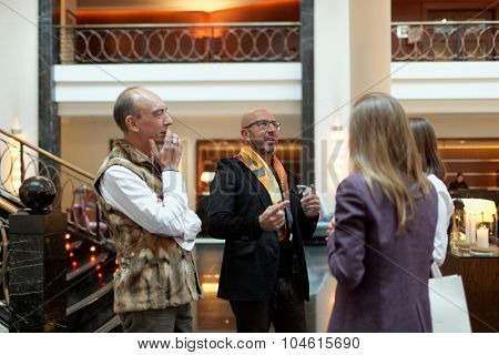 ST. PETERSBURG, RUSSIA - OCTOBER 9, 2015: Wedding stylist Mauro Adami (center) presenting his collection in Corinthia Hotel. The platinum wedding gown worth $400,000 exhibited here during next 2 days
