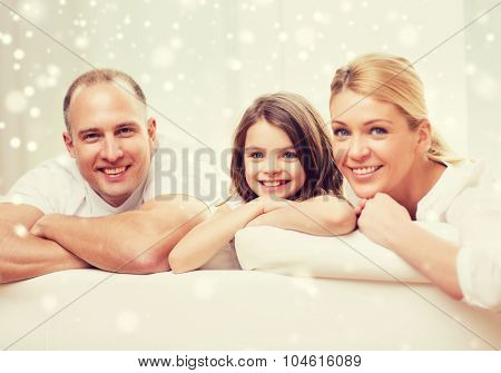 family, childhood, people and home concept - smiling parents with little girl at home