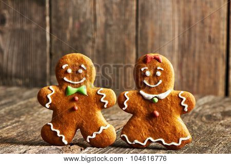 Christmas homemade gingerbread couple cookies on wooden table
