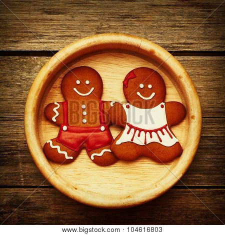 Christmas homemade gingerbread couple on table