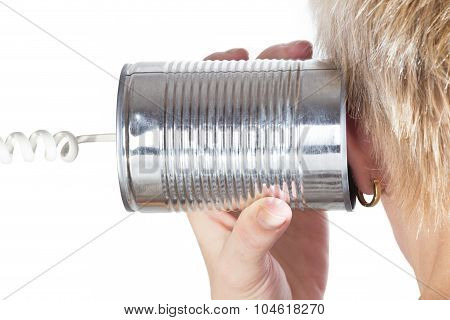 Female Hand Holding A Tin Can Phone To His Ear