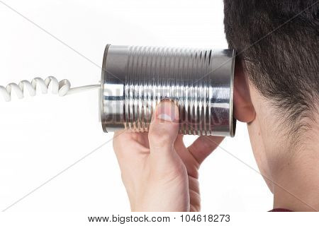 Male Hand Holding A Tin Can Phone To His Ear