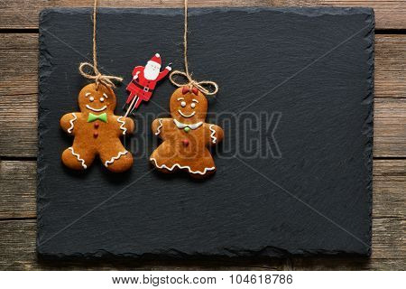 Christmas homemade gingerbread couple cookies over slate