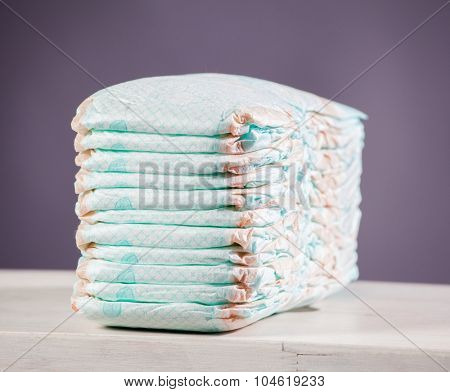 Stack of diapers. Studio Shot