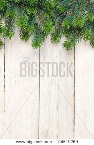 Christmas wooden background with fir tree and copy space