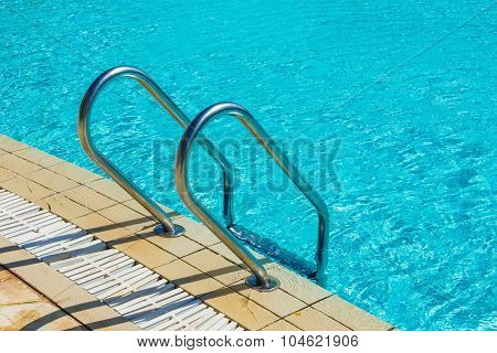 Grab Bars Ladder In The Swimming Pool