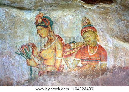 SIGIRIYA, SRI LANKA - MARCH 20, 2015: Sigiriya maiden - 5th century frescoes at the ancient rock fortress of Sigiriya in Sri Lanka