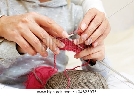 Mom Teaches A Child To Knit. Hands With Needles Close Up