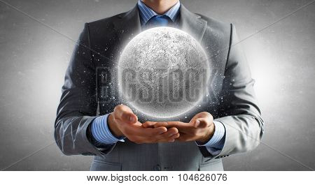 Close of businessman hands holding moon planet