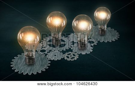 Glowing light bulbs and gears mechanism on dark background