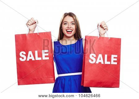 Female customer looking at camera while announcing big sale