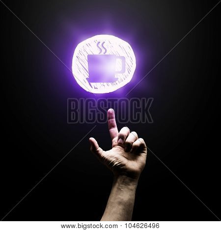 Person hand pointing with finger at glowing icon