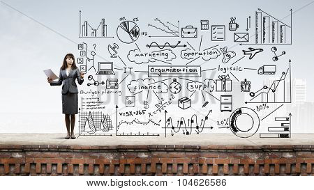 Young businesswoman drawing strategy plan on screen