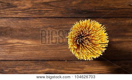 italian spaghetti on wooden background. Top view. Header for website