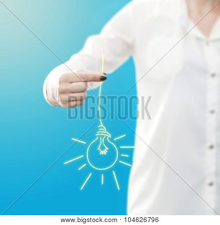 conceptual image , showing a woman holding or giving a light bulb