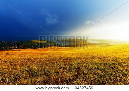 Idyllic summer landscape with  lake  and green and yellow meadow. Central Europe..